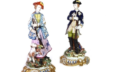 A pair of polychrome porcelain figures of a hunter and a huntress