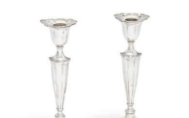 A pair of silver candlesticks William Hutton & Sons Ltd, Sheffield 1913, also stamped reg no 521572 (2)