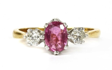 An 18ct gold pink sapphire and diamond three stone ring