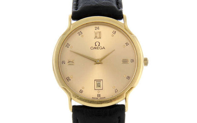 OMEGA - a mid-size yellow metal wrist watch.