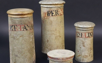 Series of three apothecary pots in turned wood. Straight shaft, interlocking lid (one lid replaced). Cartouche in painted lambel . Height 20,2 -19,5 and 14,2 cm. A model of pill box in turned wood with screw lid is joined. Cartouche in periphery...