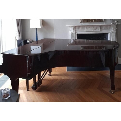 Steinway (c2009) A 6ft 11in Model B grand piano in a bright...