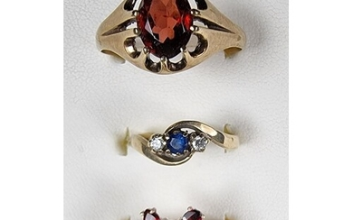 A 9ct gold sapphire and diamond three stone ring, a 9ct gold...