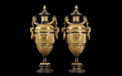 A LARGE AND IMPRESSIVE PAIR OF LATE 19TH CENTURY FRENCH BRONZE URNS AND COVERS IN THE MANNER OF FERDINAND BARBEDIENNE
