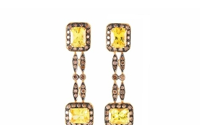 A PAIR OF YELLOW SAPPHIRE AND BLACK DIAMOND EARRINGS, of clu...