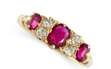 A RUBY AND DIAMOND DRESS RING set with a trio of