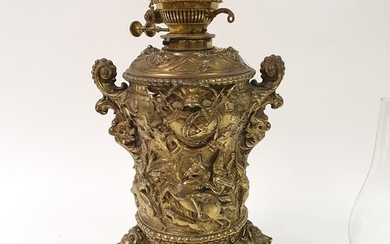 A brass oil lamp, lacking shade, decorated heraldic forms, 6...