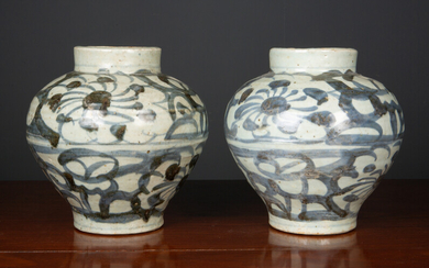 A pair of antique South East Asian jars