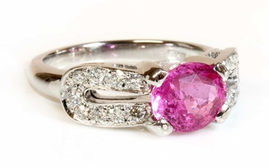 An 18ct white gold pink sapphire and diamond ring