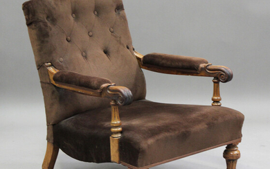 An early Victorian walnut framed gentleman's armchair with finely carved scroll handrests, upho
