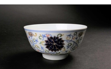 A Chinese doucai Lotus bowl, painted with blue lotus flowers...