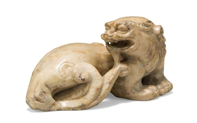 A Chinese soapstone 'bixi' carving, Ming dynasty, carved in a recumbent pose with head turned back towards the body, 7cm long