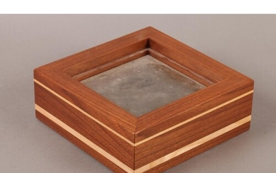 A Linley walnut and polished steel candlestand of square ou...