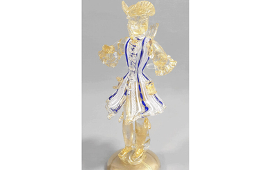 A glass Goldonian figure with gold leaf and blue and lattimo filigree