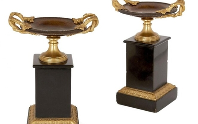 A pair of French gilt and patinated bronze tazze, late 19th century, each with naturalistic vine twin handles, on black marble pedestal bases, 24.5cm high (2)