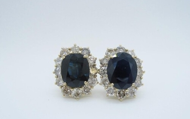 A pair of Sapphire and Diamond Cluster Earrings, each claw-s...