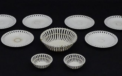A quantity of Continental creamware chestnut baskets