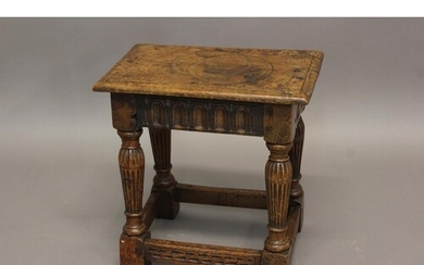 AN OAK JOINT STOOL OF 16TH CENTURY DESIGN with gouged frieze...