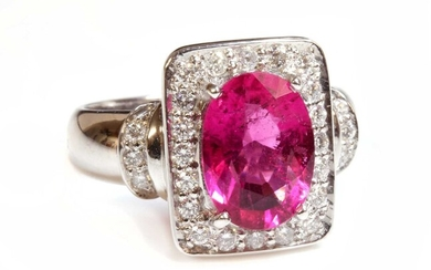 An 18ct white gold pink tourmaline and diamond rectangular plaque ring