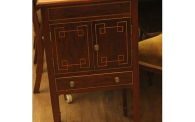 An Edwardian inlaid mahogany pot cupboard, adapted from a wi...