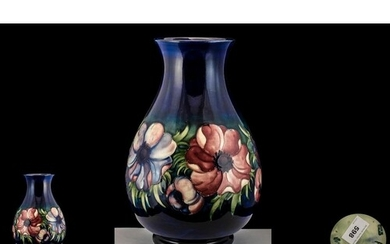 Large Moorcroft Bulbous Shaped Vase on a Blue Ground Body, I...