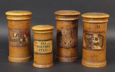 Set of four turned wooden apothecary pots with interlocking lids. Height 16,5 cm and 12,5 cm