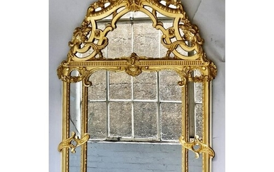 WALL MIRROR, mid 18th century style French carved giltwood w...