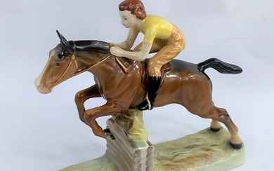 A Beswick group of girl on jumping horse 939, length 26cm (t...