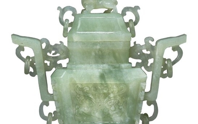 A Chinese bowenite twin-handled vase and cover, early 20th century, the handles carved with chilong dragons and rings, the exterior with panels of archaistic motifs, the cover surmounted with a Buddhist lion, 20cm high