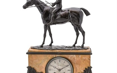A FRENCH LOUIS PHILIPPE PATINATED BRONZE AND SIENA MARBLE FIGURAL EQUESTRIAN MANTEL CLOCK