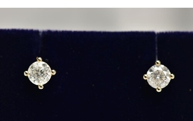 A PAIR OF 9CT GOLD DIAMOND STUD EARRINGS, each fitted with a...