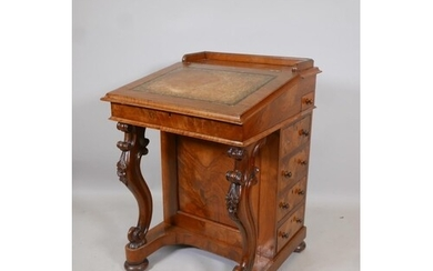 A Victorian figured walnut davenport with carved piano legs,...