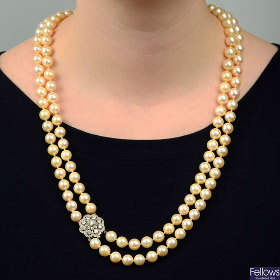A cultured pearl two-row necklace, with 9ct gold diamond cluster clasp.