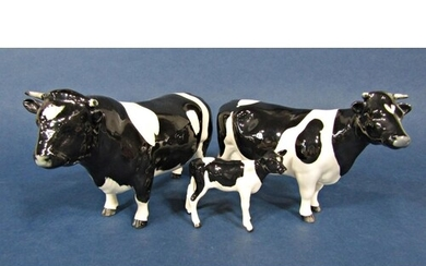 A family of three Beswick Friesian cattle comprising bull, c...
