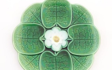 A majolica plate with stylised water lily flower