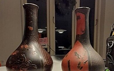NOT SOLD. A pair of Japanese Meiji porcelain vases with black lacquer surface decorated with...