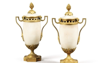 A pair of Louis XVI gilt-bronze-mounted white marble vases and covers, possibly Italian