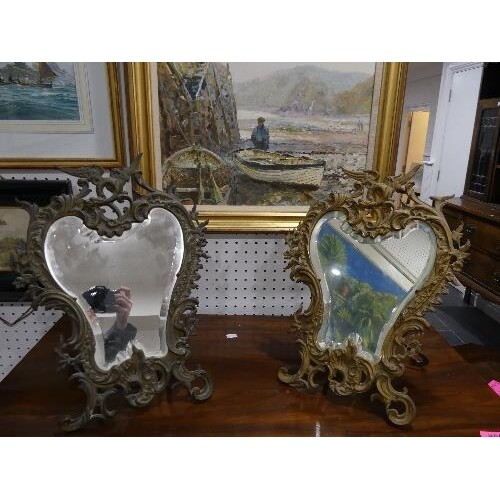 A pair of early 20th century gilt metal Easel Mirrors, with ...