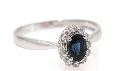 NOT SOLD. A sapphire ring set with a sapphire encircled by diamonds, mounted in 18k white gold. Size 55. – Bruun Rasmussen Auctioneers of Fine Art