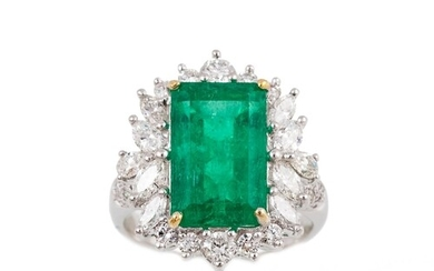 AN EMERALD AND DIAMOND CLUSTER RING, the rectangular cut eme...