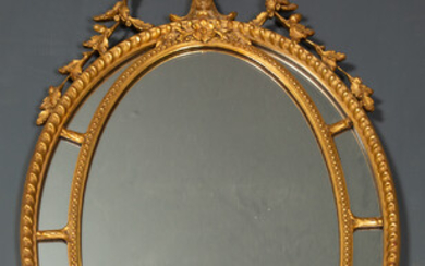 An Adam's style gilded gesso oval wall mirror