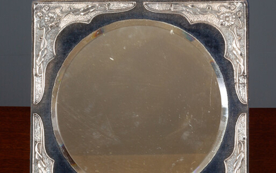 An Edwardian silver mounted dressing table mirror
