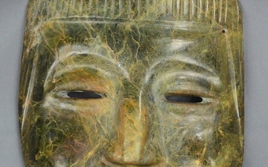 Stone mask, in the shape of a human head, flat nose, and a clearly raised cheek, slits for mouth an
