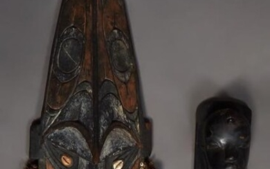 Two African Carved Figures, 20th c., one a tall mask