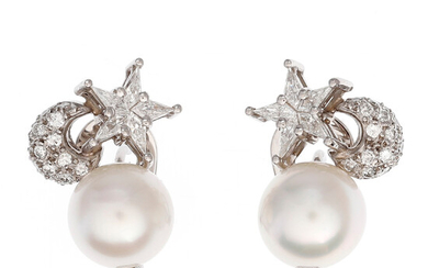 You and me earrings with Australian pearls and diamonds in the shape of a star and moon.