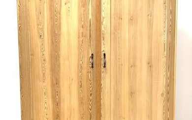 20th century stripped pine double wardrobe, projecting cornice over...