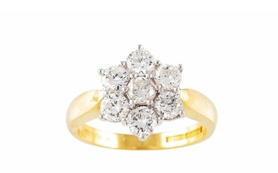 A DIAMOND SEVEN STONE DRESS CLUSTER RING, mounted in 18ct ye...