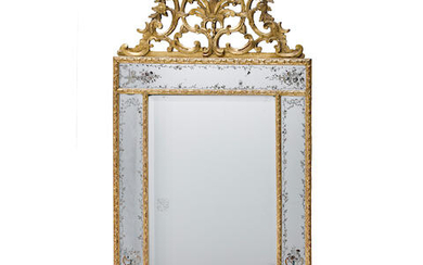 A RÉGENCE STYLE CARVED GILTWOOD MIRROR