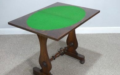 A Victorian walnut games Table, the rectangular fold-over to...