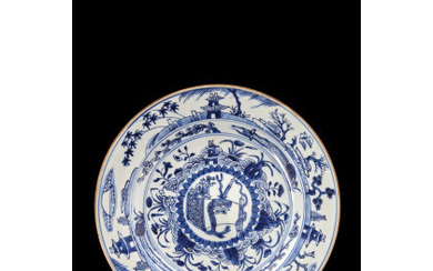 A blue and white porcelain plate, decorated with pagodas and shrubs (slight defects) China, Qing dynasty, Kangxi period (1662-1722) (d.…Read more